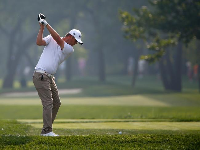 Matt Jones of Australia hits a tee shot during a practice round prior to the start of the 96th PGA Championship.