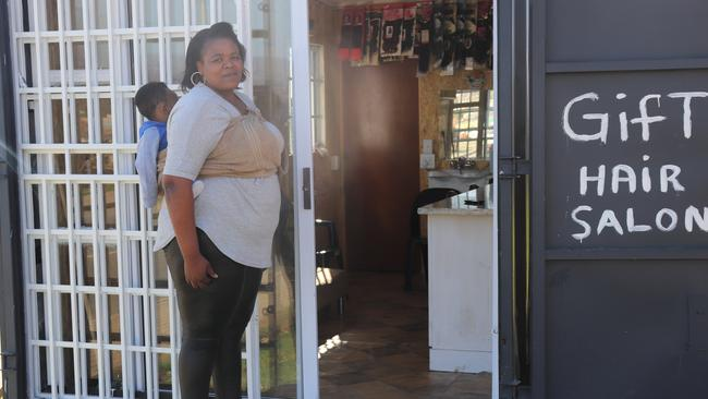 Knysna hairdresser Happiness, 30, goes to work everyday in a shipping container she has rented to run her business, 'Gift Salon' — which she named after her son Gift — but is yet to have her first customer.