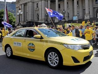Taxi drivers protest outside Parliament house in Melbourne over Government deregulation plans for the Taxi industry, in Melbourne, Monday, Feb. 13, 2017. (AAP Image/Joe Castro) NO ARCHIVING