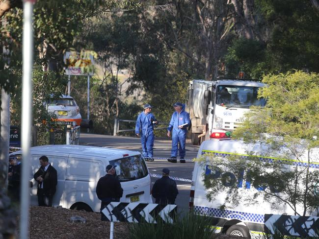 Police at the scene where Dane McNeill's body was discovered in Lambeth Reserve at Picnic Point.