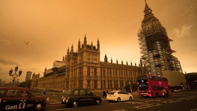 The sky over central London has turned orange as the remains of Hurricane Ophelia whips up dust from the Sahara desert.