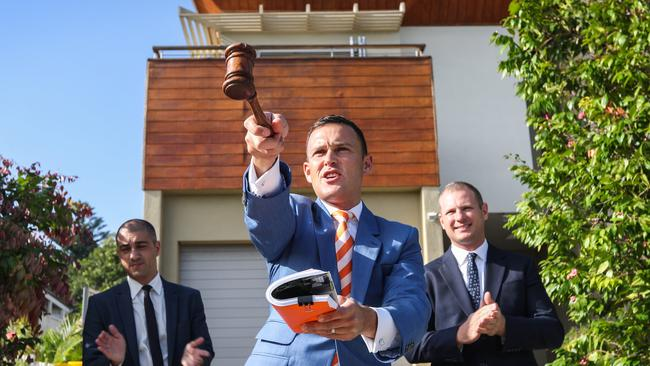 Auctioneer Damien Cooleyin action at a property sale in Sydney.