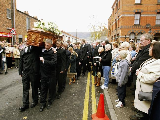 Remembered three decades after her death ... the sons of Jean McConville carry her remains, which were found in a shallow grave above a beach, at her 2003 funeral in 2003 in Belfast.
