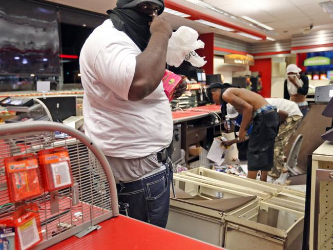 Out of control ... looters going through a store in Ferguson, Missouri. Picture: AP /St. Louis Post-Dispatch, David Carson