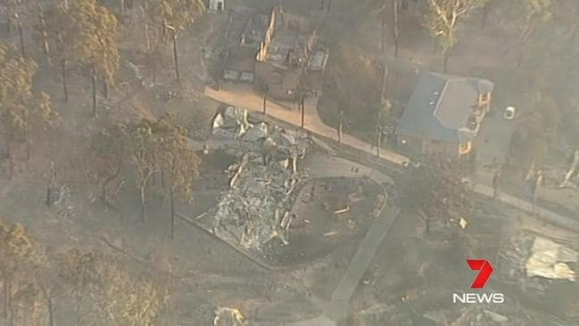 An aerial view of the devastation caused by the bushfire that swept through Tathra yesterday. Credit: 7 NEWS