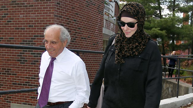 Katherine Russell, right, wife of Boston Marathon bomber suspect Tamerlan Tsarnaev, leaves the law office of DeLuca and Weizenbaum with Amato DeLuca. (AP Photo/Stew Milne)