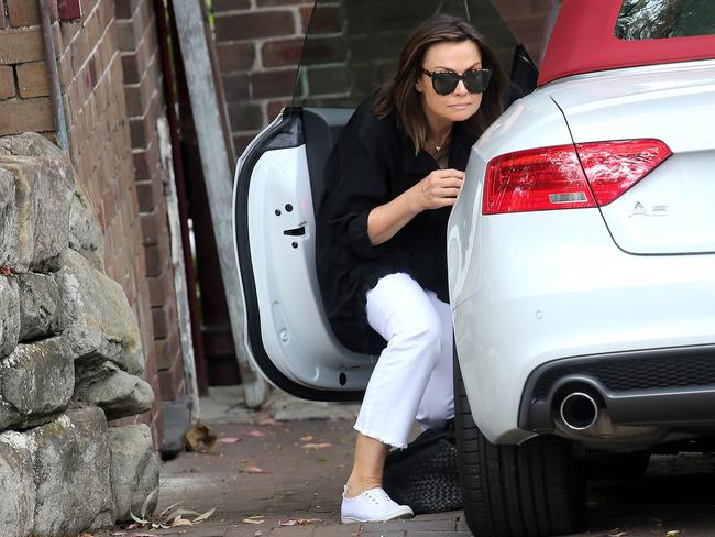 Lisa Wilkinson hid behind her Audi in her driveway last October after being hounded by the paparazzi following her decision to leave Today. Picture: Dimex