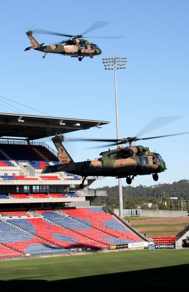 In anticipation ... Blackhawk helicopters from No. 171 Aviation Squadron No. 6 Aviation Regiment hover above Hunter Stadium Newcastle during a training exercise. Source: Defence