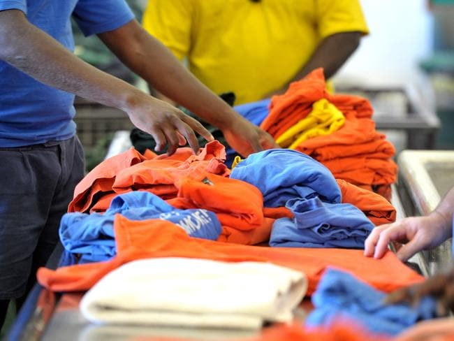 Prisoners working in the laundry at the Darwin Correctional Centre in Berrimah. Picture: Justin Sanson