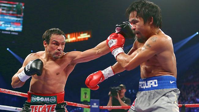 Juan Manuel Marquez throws a left to the face of Manny Pacquiao.