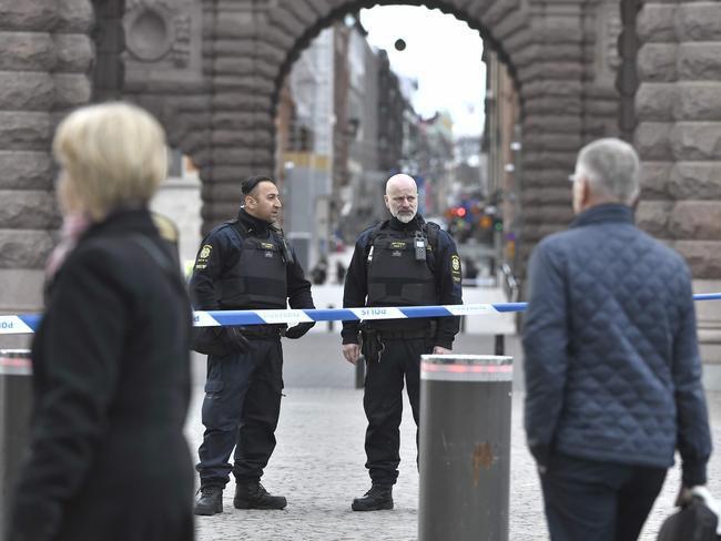 Police stand guard outside the Swedish Parliament following the deadly truck attack.