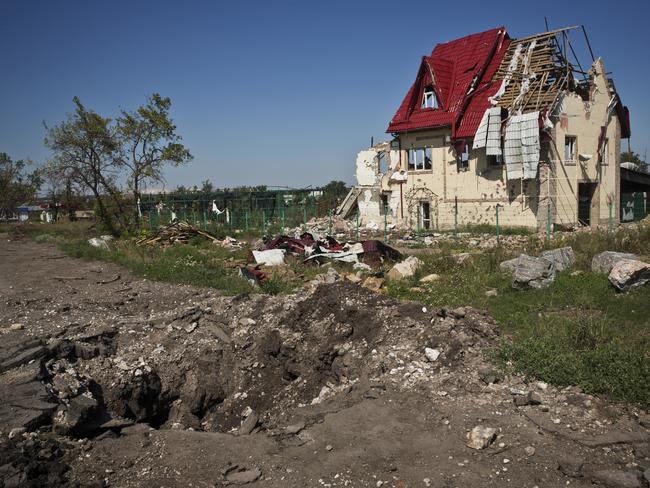 Danger zone ... this crossroad near Sloviansk shows the scars of battle. Picture: Ella Pellegrini