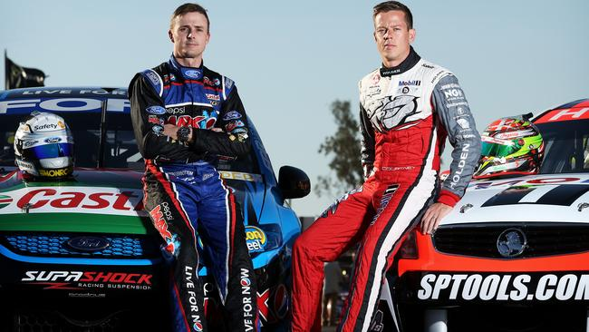Mark Winterbottom and James Courtney pose for photos at Queensland Raceway in Ipswich.