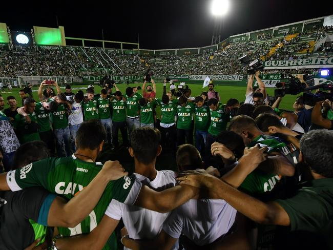 Players of Brazil's Chapecoense football club participate in a tribute to their fellow players killed in a plane crash Monday night in Colombia, at the club's stadium in Chapeco, Santa Catarina, Brazil.