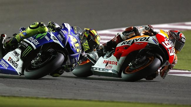 Marquez sweeps into the lead after Rossi runs wide.