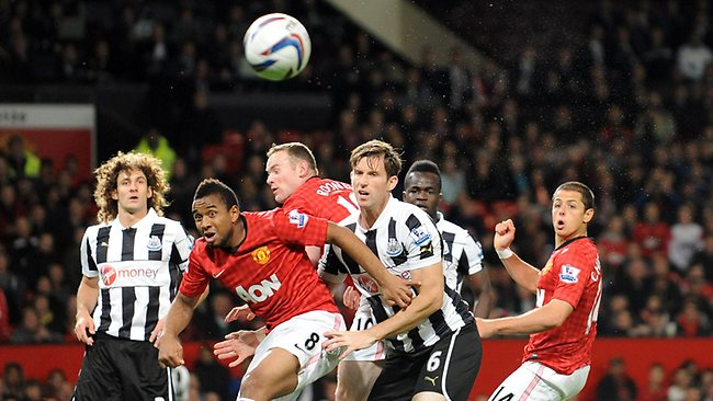 Manchester United's Javier Hernandez, right watches his header go wide of the goal during their English League Cup third round match against Newcastle United at Old Trafford. Picture: Clint Hughes