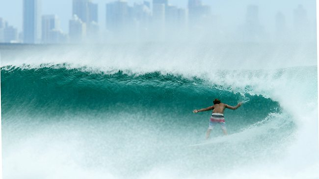 WILD WAVES: Surfers at Kirra Point make the most of the swell caused by the passing Cyclone Sandra. Pic: Scott Fletcher