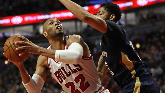 Taj Gibson #22 of the Chicago Bulls moves against Anthony Davis #23 of the New Orleans Pelicans.