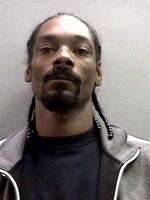 Snoop Dogg was booked on a felony charge of possession of a dangerous weapon in November 2006. Snoop (real name: Calvin Broadus) posed for the below mug shot while being processed by the Orange County Sheriff's Department. He was charged in connection with an incident at John Wayne Airport during which security personnel discovered a collapsible baton in his luggage.
