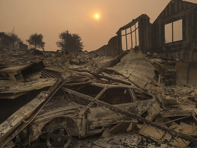 The sun rises through a cloud of smoke after a wildfire swept through the area in Sonoma County. Picture: AP