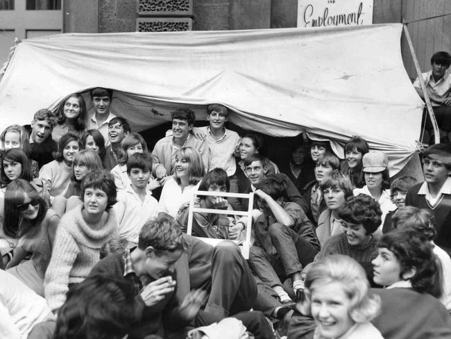Beatles fans crowd under a makeshift canvas shelter on North Terrace in the wait for tickets in 1964.