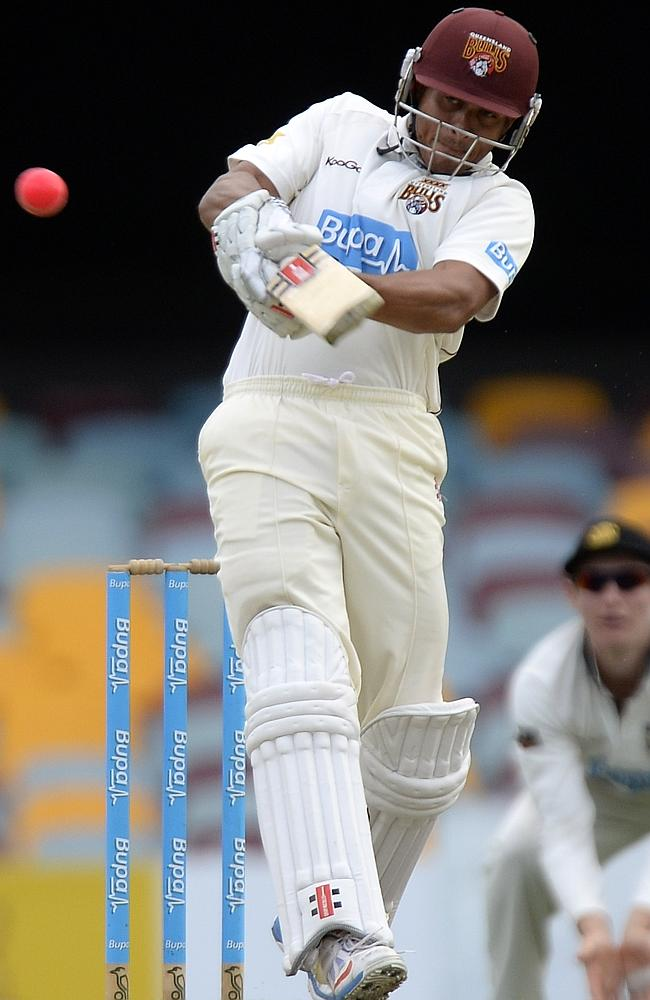 Usman Khawaja hits the ball to the boundary to help establish Queensland's dominance.