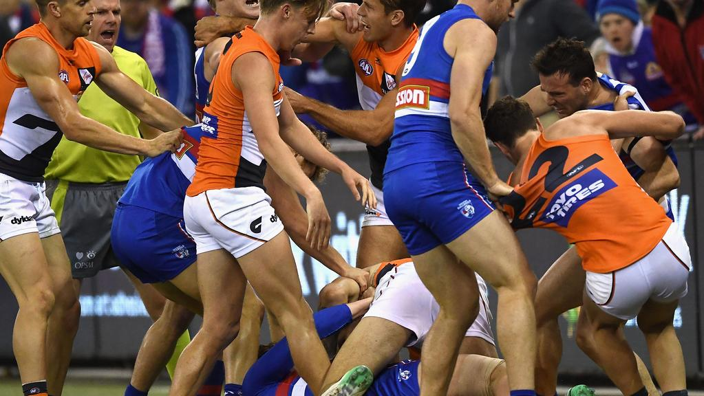 Toby Greene feels the wrath of Bulldogs players. Picture: Getty Images