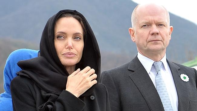 Respectful ... Angelina Jolie and British Foreign Minister William Hague pay their respects at Srebrenica-Potocari Genocide Memorial cemetery in Sarajevo. Picture: AFP