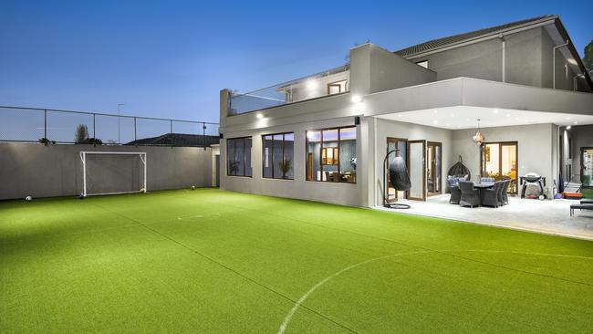 There is plenty of entertaining and recreational space in the backyard.