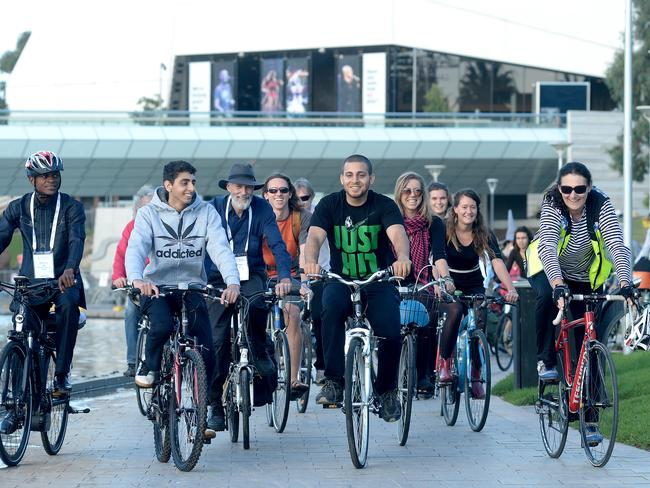 UNCOVERED: Cyclists set off on the helmetless ride from the Adelaide Convention Centre. Picture: Keryn Stevens