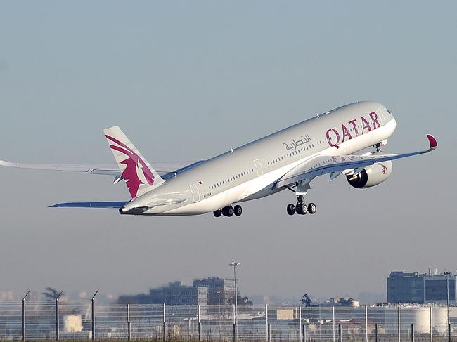 (FILES) This file photo taken on December 22, 2014 shows a Qatar Airways A350 taking off from the Airbus headquarters in Toulouse. Qatar Airways on June 6, 2017 announced it had suspended all flights to Saudi Arabia, the UAE, Bahrain and Egypt, in the wake of a diplomatic boycott against Doha by regional powerhouses. / AFP PHOTO / REMY GABALDA