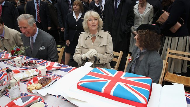 Prince Charles, Prince of Wales and Camilla, Duchess of Cornwall attend the 'Big Jubilee Lunch' in Piccadilly ahead of the Diamond Jubilee River Pageant Sunday June 3, 2012 in London, England. (AP Photo /Chris Jackson, Pool)