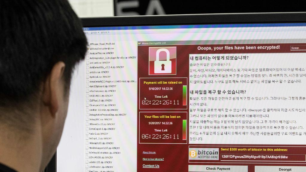 he ransomware WannaCry shut down businesses and hospitals and sent people reaching for paper and pen. Picture: AFP PHOTO