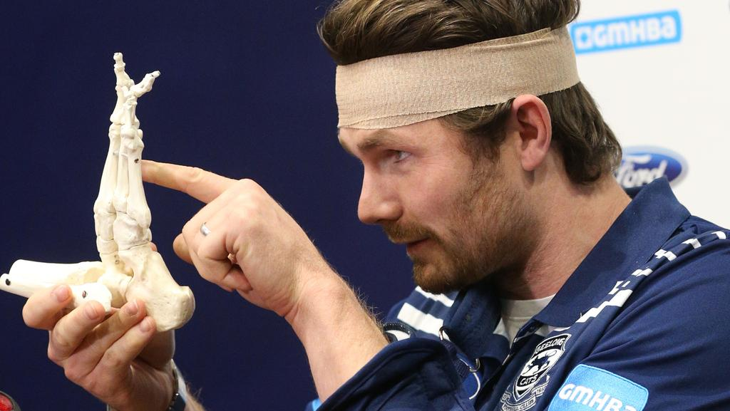 Patrick Dangerfield makes fun of his foot injury at a press conference on Monday. Picture: Mark Wilson.