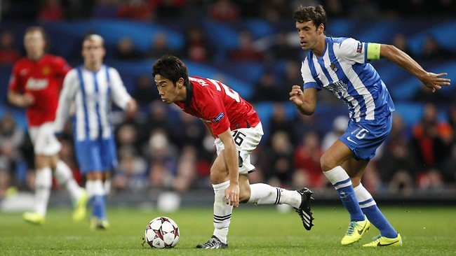 Manchester United's Shinji Kagawa, left, keeps the ball from Real Sociedad's Xabi Prieto during the Champions League group A soccer match.