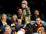 An angry Tigers supporter fires one last shot at a Crows fan on his way out of the G.