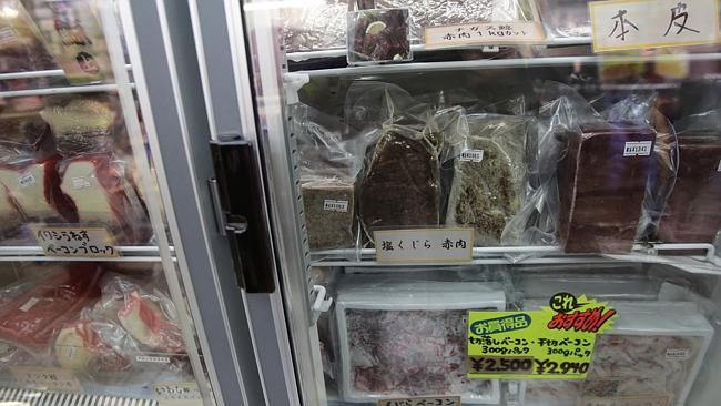Packs of whale meat to be sold sit in a freezer at a whale meat specialty store at Tokyo's Ameyoko shopping district, Thursday, March 27, 2014. AP Photo/Shizuo Kambayashi