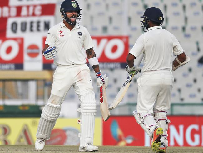 Virat Kohli, left, and Parthiv Patel celebrate as India beat England.