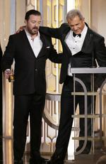 Host Ricky Gervais and presenter Mel Gibson speak onstage during the 73rd Annual Golden Globe Awards at The Beverly Hilton Hotel on January 10, 2016 in Beverly Hills, California. (Photo by Paul Drinkwater/NBCUniversal via Getty Images)