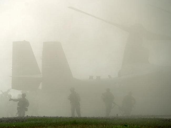 "Fog of words ... US Marines disembark from an MV-22B Osprey aircraft during the ""Platinum Eagle 15"" military exercise at training facilities in Babadag, Romania yesterday. Source: AFP"