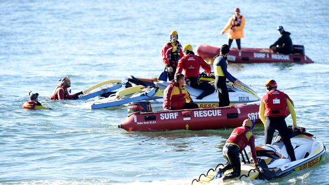 Emergency surf life saving personnel resume the search for a missing 5 year old boy, who was swept into the ocean at Pearl Beach, Central Coast. Picture: Peter Clark.