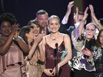"Taylor Schilling and the cast of ""Orange Is the New Black"" accept the award for outstanding performance by an ensemble in a comedy series at the 23rd Annual Screen Actors Guild Awards. Picture: AP"