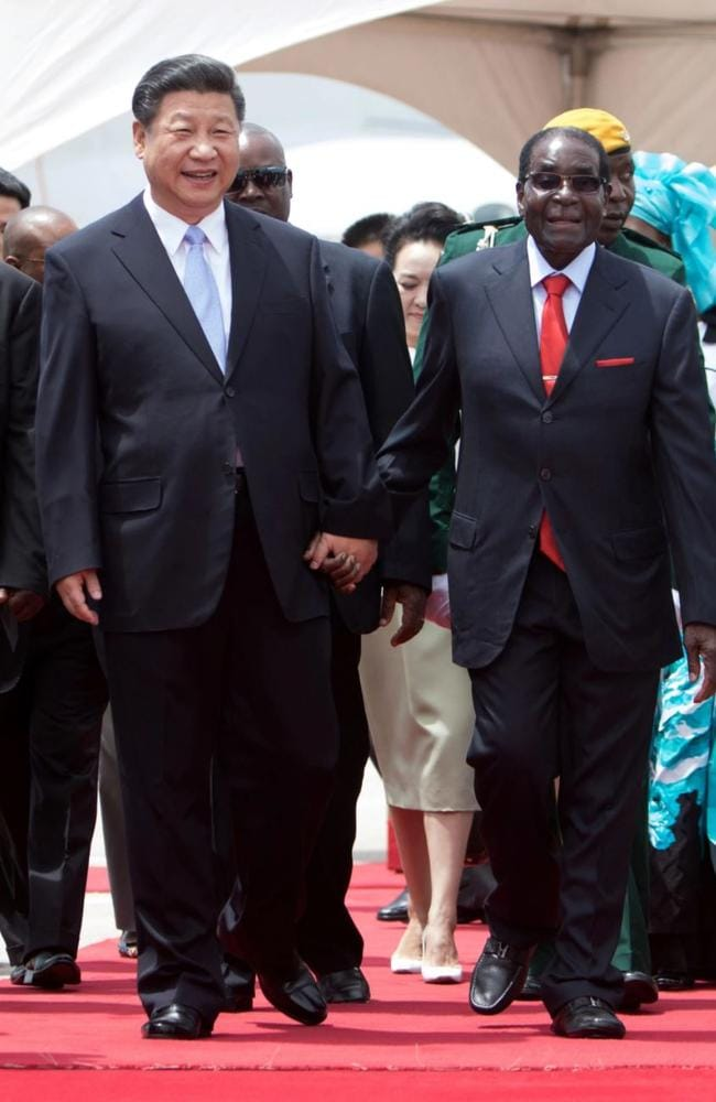 Chinese President Xi Jinping walks hand in hand with Zimbabwe's President Robert Mugabe during a visit to Harare in December 2015. Picture: AFP