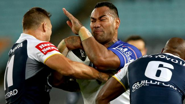 Bulldog's Tony Williams tackled by Cowboy's Tariq Sims.