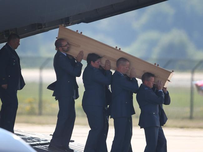 'All Australians' ... Dutch military personnel carry a coffin containing an unidentified body from a Royal Australian Air Force C-17. Picture: Peter Macdiarmid