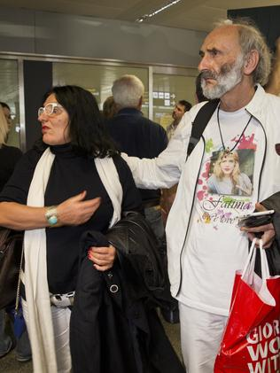 Faith or denial? ... George Dyczynski wore a T-shirt with Fatima's photo when the couple landed in Kiev. Picture: Ella Pellegrini
