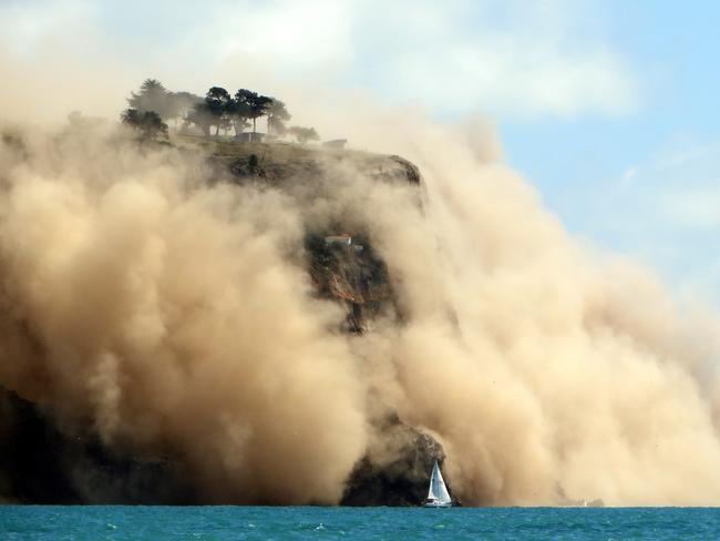 Force of nature ... Godley Head on Banks Peninsula wreathed in dust after the 5.7 quake struck Christchurch. Picture: Supplied