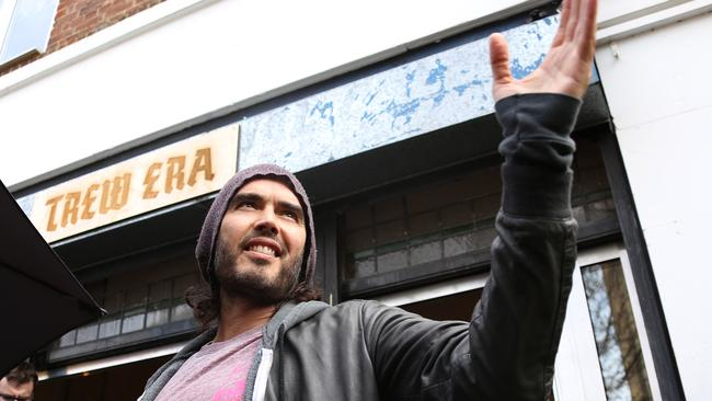 World brew ... Russell Brand outside his socially conscious Trew Cafe Era in Hackey. Picture: Joel Ryan/Invision/AP, File