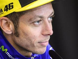 (FILES) This file photo taken on August 10, 2017 shows Valentino Rossi of Italy attending a press conference prior to the MotoGP Austrian Grand Prix weekend at Red Bull Ring in Spielberg, Austria. Crash victim Valentino Rossi was confirmed as a non-starter for this weekend's San Marino MotoGP, his Yamaha team announced on September 4, 2017. The Italian nine-time world champion is recovering from a broken leg after a training crash last week. / AFP PHOTO / Jure Makovec