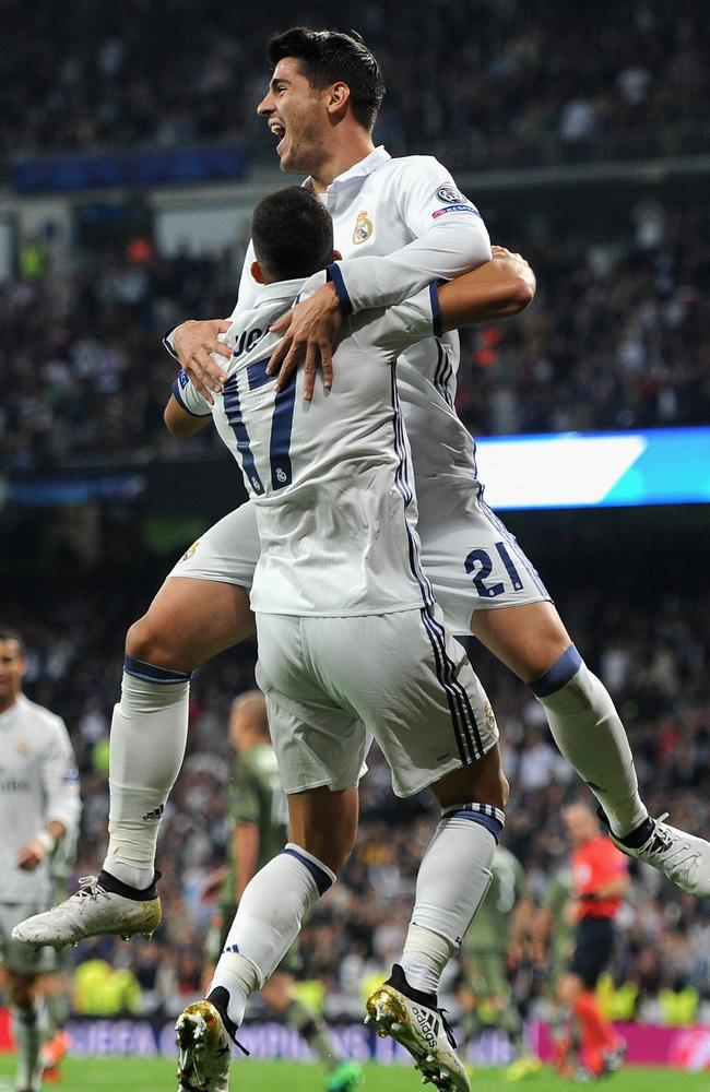 Lucas Vazquez (front) of Real Madrid celebrates.